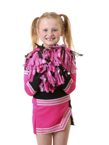 young girl dressed in a cheerleader outfit